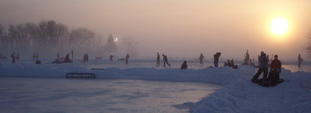 Hockey players getting ready to play at the US Pond Hockey Championships on Lake Nokomis