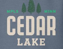 Detail of indigo Cedar Lake hooded sweatshirt graphic