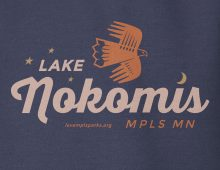 Detail of navy Lake Nokomis hooded sweatshirt graphic