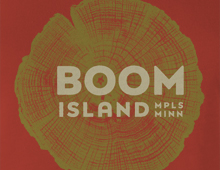 Close-up image of Boom Island t-shirt graphic on red