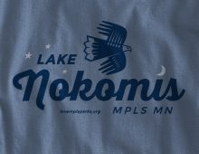 Detail of Lake Nokomis long-sleeve t-shirt on Indigo Blue
