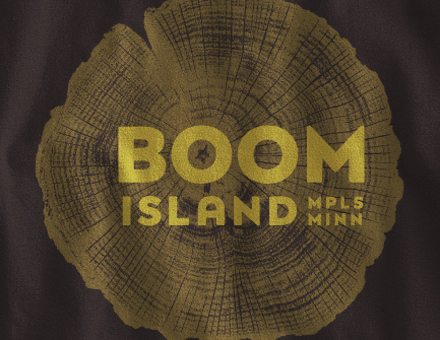 Detail of Boom Island design on black long-sleeve t-shirt