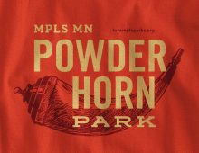 Detail of Powderhorn Park design on red long-sleeve t-shirt