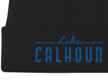 Detail of black Lake Calhoun embroidered knit cap with blue letters