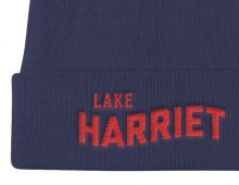 Detail of navy Lake Harriet embroidered knit cap with red letters