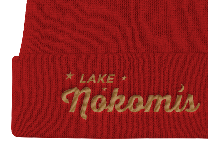 Detail of red Lake Nokomis embroidered knit cap with old gold letters
