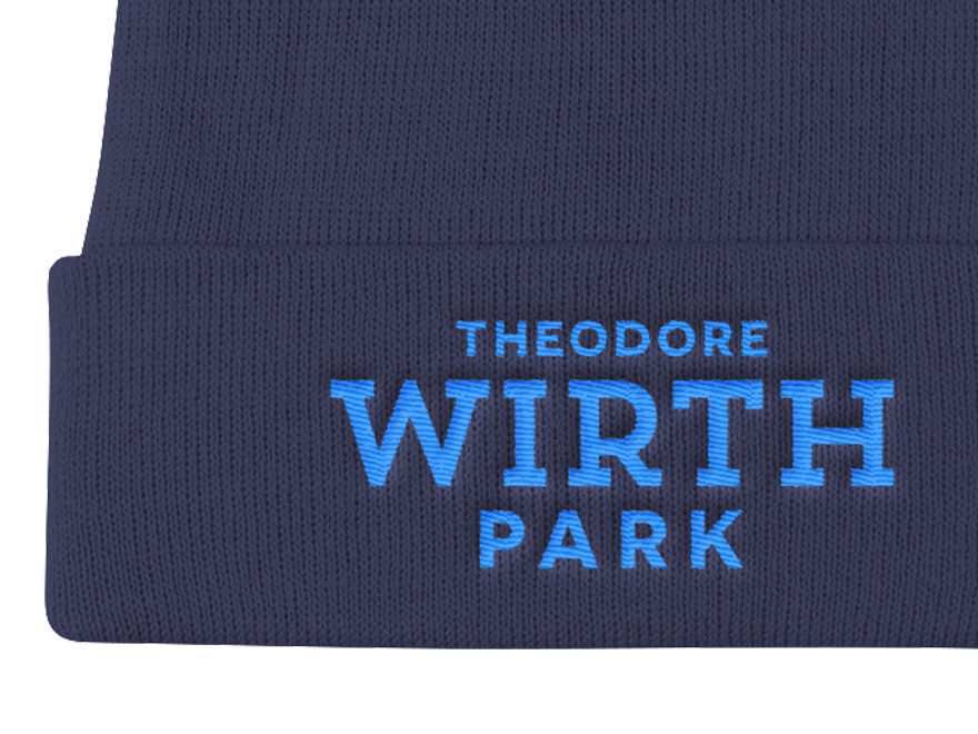 detail of navy Wirth Park embroidered knit cap with light blue letters