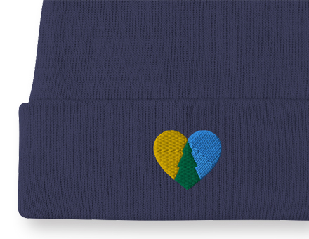 Close-up view of embroidered LoveMplsParks heart design on navy blue winter beanie