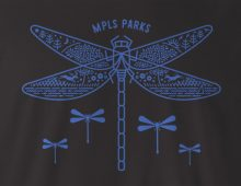 Close-up view of MPLS Parks Dragonfly T-shirt – bright blue design on black t-shirt