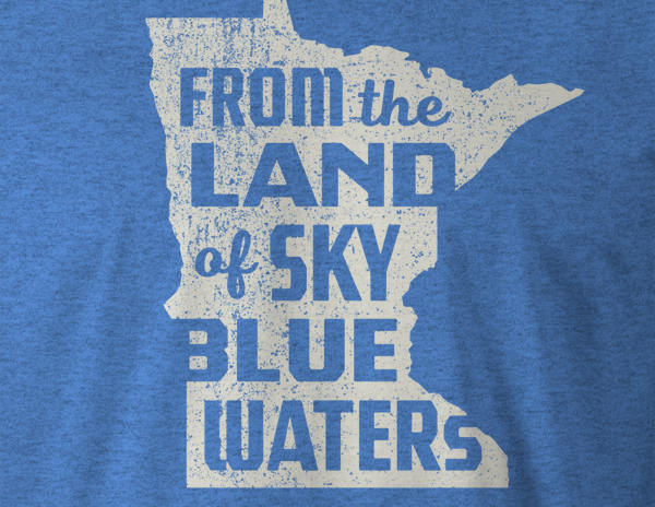 Close-up detail of t-shirt with outline of the state of Minnesota – From the Land of Sky Blue Waters