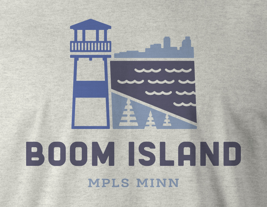 Close up view of Boom Island logo design on ash gray t-shirt