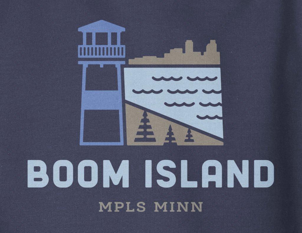 Close up view of Boom Island logo design on navy hooded sweatshirt