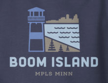 Close up view of Boom Island logo design on navy hooded sweatshirt