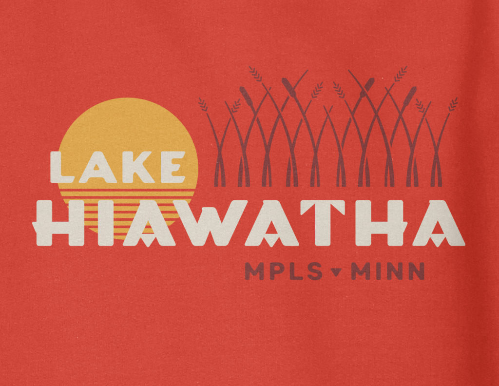 Close up view of Lake Hiawatha logo design on red hooded sweatshirt