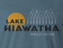 Close up of Lake Hiawatha logo design on deep teal t-shirt