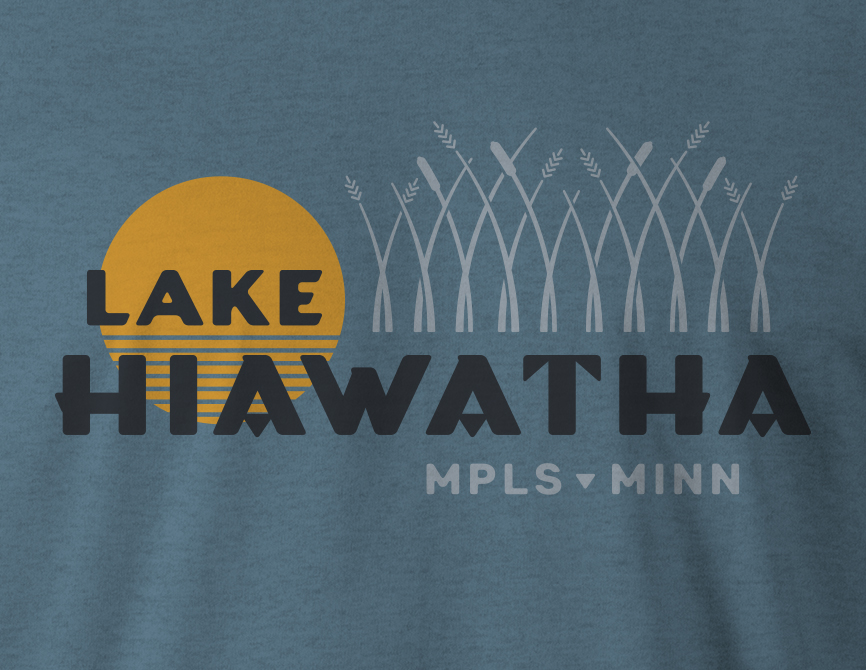 Close up of Lake Hiawatha logo design on deep teal t-shirt